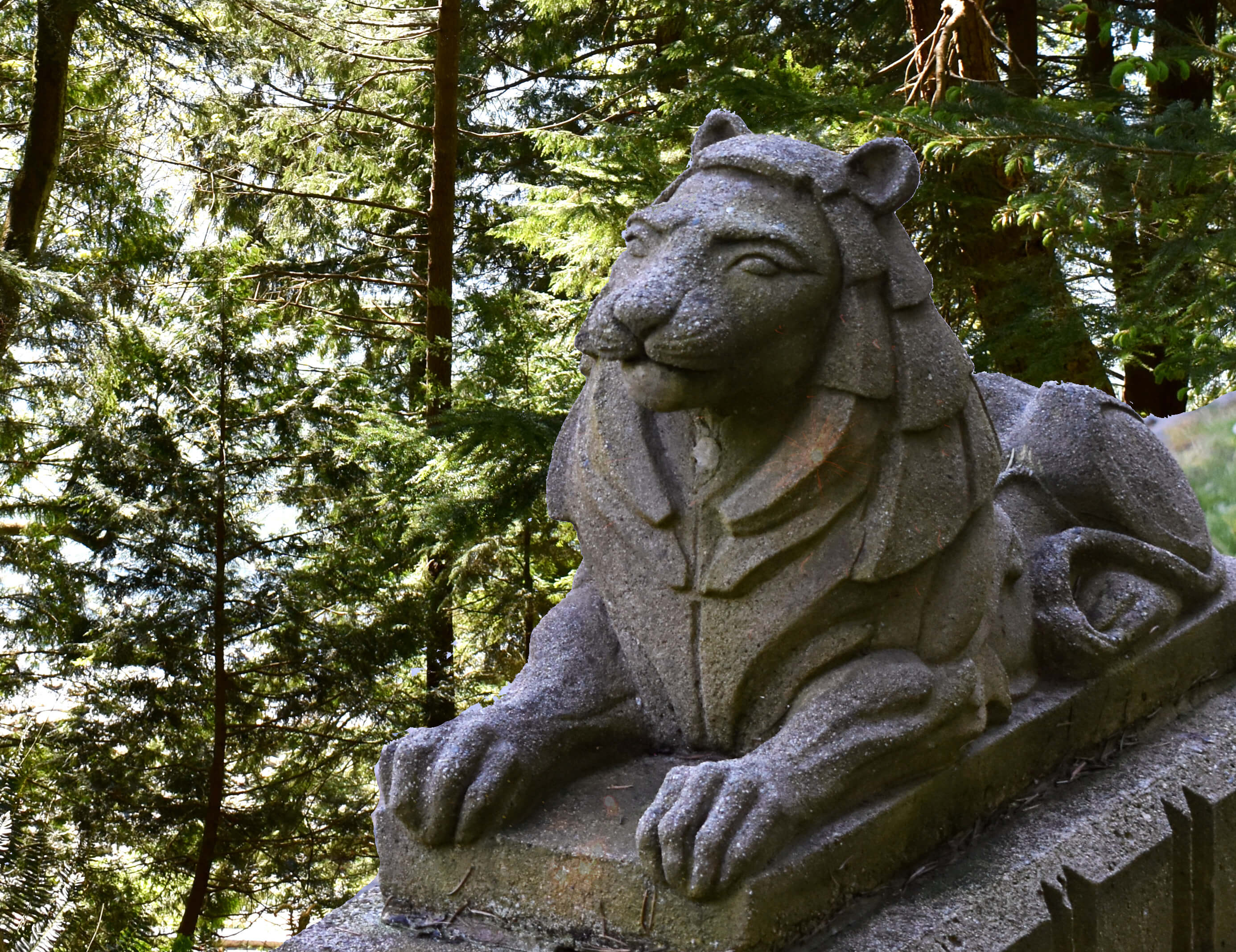 Stone lion in a forest - Stanley Park, BC